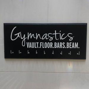 Black Gymnastics Logo Medal and Ribbon Hanger